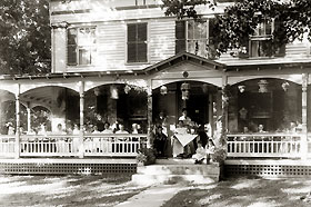 A tea party hosted by Louise C. Beach, around 1920.