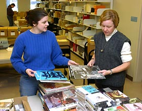 Image: Elizabeth Watts and Kristin Eshelman look over the Charters collection.