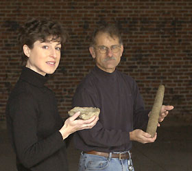 Image: Leanne Harty and Nicholas Bellantoni hold artifacts from the University's archaeology collections.