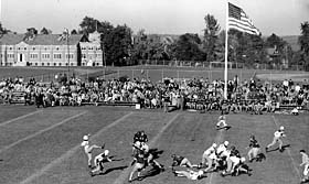 Image: A football game on Dow Field around 1942. To the right rear is the baseball diamond.