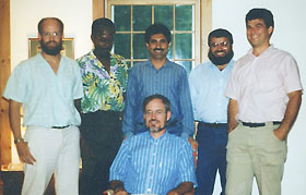 Image: Hajim Al-Hasani with students and Prof. Ron Cotterill