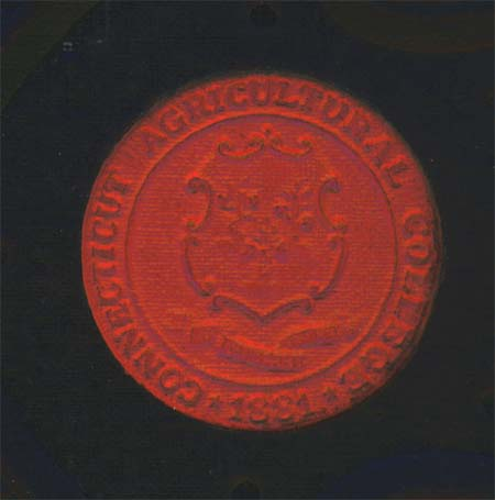 Cover detail: the college seal.